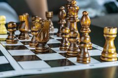 White and black chess on the Board. White and black chess on the chessboard playing a game stock photography