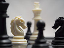 White and black chess pieces on a chessboard Royalty Free Stock Image