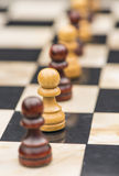 White and black chess pieces on a chessboard Royalty Free Stock Images