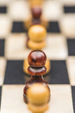 White and black chess pieces on a chessboard Stock Photo