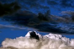 White and black clouds together Stock Images