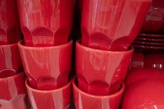 A lot of red cups are on the shelf. stock photo
