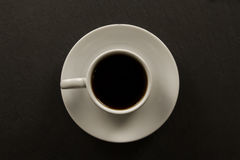 White black Cup of coffee on black background. Stock Image