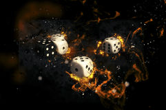White and black dices on fire. Royalty Free Stock Photography
