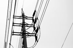 White and black Electric pole. And sky in Thailand Stock Images