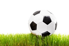White and black football on a grass surface Stock Photo