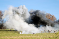 White and black fume on the battlefield Royalty Free Stock Images