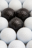 White and black golf balls in the box Royalty Free Stock Photo