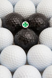 White and black golf balls and wooden tee Stock Photos
