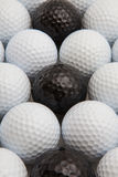 White and black golf balls and wooden tees. Different golf balls and wooden tees Stock Images