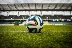 White Black and Green Soccer Ball on Soccer Field Stock Photography