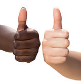 White and black hand doing thumbs up. Royalty Free Stock Photos