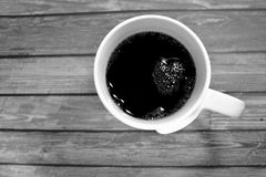 White and black high angle shot of a cup of coffee.  Royalty Free Stock Images