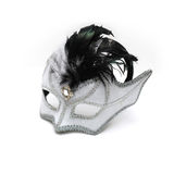 White and black mask. White and black carnival mask decorated with feathers isolated on a white background Stock Image