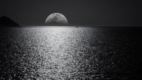 White and Black Moon With Black Skies and Body of Water Photography during Night Time Royalty Free Stock Photo