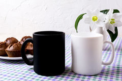 White and black mug mockup with chocolate muffins Stock Photography