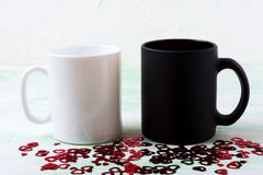 White and black mug mockup with red glitter hearts Royalty Free Stock Photo