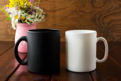 White and black mug rustic mockup with wildflowers in pink vase Stock Photos