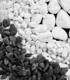 White and black pebble stones Stock Photography