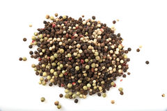 White and black peppercorn Stock Images