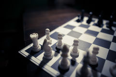 White and black pieces on chess board Stock Photography