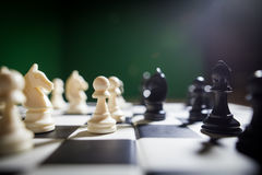White and black pieces on chess board Stock Photos