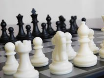 White and black pieces of chess Stock Photos