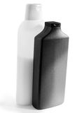 White and black  plastic bottles with shampoo and mask for hair Stock Photos