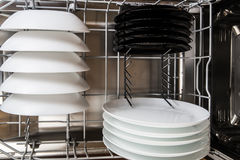 White and black plates after cleaning Royalty Free Stock Photo