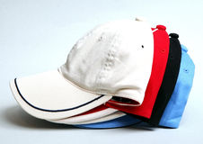 White , black , red and blue baseball cap on a white background. 4 Stock Images