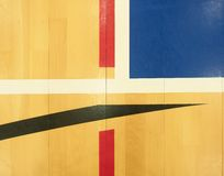 White, black red lines, blue playfield in sports hall. Renewal wooden floor of sports hall with colorful marking lines and new lacquered surface Stock Images