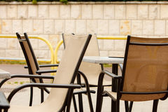 White and black restaurant chairs outdoor. Open cafe. Stock Image