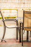 White and black restaurant chairs outdoor. Open cafe. Stock Photography