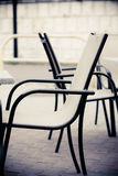 White and black restaurant chairs outdoor. Open cafe. Stock Photos