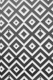 White and black rhombuses on old doors. Photo in black and white. Elements of design in the form of geometric figures - black and white rhombuses on the ancient Stock Photo