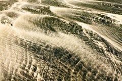 White and black sand beach Stock Photo