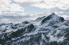 White and Black Snow Mountain Under White Cloudy Sky during Daytime Stock Photos