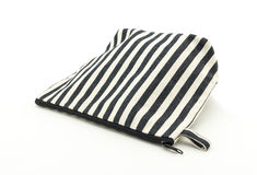 White and black striped fabric cosmetic bag on white background Stock Photos
