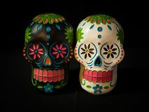White and Black Sugar Skulls. A black and white sugar skull for Dias de la muerte or day of the dead a mexican celebration Royalty Free Stock Image