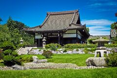 White and Black Temple Surrounded by Green Grass Field during Daytime Royalty Free Stock Images