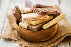 White and Black Wafer Biscuits. In wooden bowl on linen Royalty Free Stock Photos