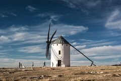 White and Black Windmill Building Stock Image