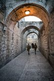 White and black women in military uniform walking in narrow street of the old city of Jerusalem. Jerusalem, Israel: 24 October, stock photo