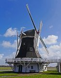 White and Black Wooden Windmill during Daytime Stock Image