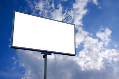White blank billboard. On blue cloudy sky background Royalty Free Stock Photo