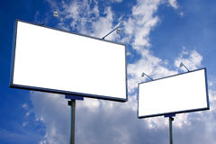 White blank billboard. On blue cloudy sky background Royalty Free Stock Image