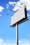 White blank billboard. Blank billboard on blue sky stock images