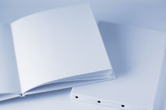 White blank book and new canvas. Book and canvas Royalty Free Stock Photo