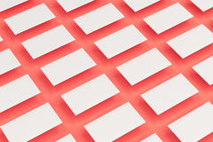 White blank business cards mock-up on red background Stock Photography