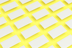 White blank business cards mock-up on yellow background. Corporate stationery template. 3D rendering illustration Royalty Free Stock Images